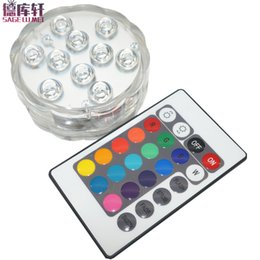 Base encendida a pilas online-4 set Led de luz sumergible con pilas 5050 chips RGB Impermeable IP68 Florero Base de luz brillante lámpara Blub Home Party Supplies