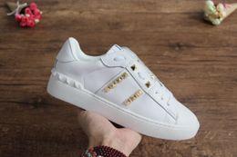 Top-gummischuhe online-Hochwertige Mode Damen Herren Designer Schuhe mit Nieten elf Gummisohle Casual Sneakers für Männer, Frauen, Größe 34-46