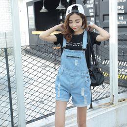 a9549fe1032 2017 Korean style women hole braces cowboy shorts jumpsuits suspenders  loose big yards denim shorts female short design overalls