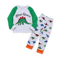 Niño vistiendo pijamas online-Niño Pijamas de Dinosaurio de Manga Larga Conjunto Baby Letter Print Traje de Desgaste de Ocio Niños Ropa Ropa Dos Piezas CN G037