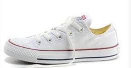 Zapatos color eva online-Hola Envío de la gota A estrenar Colores Todos los tamaños 35-46 High Top estrellas deportivas Low Top Classic Zapatillas de lona Zapatillas de deporte de los hombres de las mujeres Zapatos ocasionales aaaa