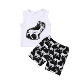 Wholesale toddlers sleeveless t shirts - Toddlers cute deer pineapple cartoon printing summer outfits 2pc sets sleeveless white printing T shirts+short pants baby casual beach cloth