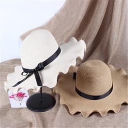 Fiore ondulato online-Cappelli di paglia Donna Big Wavy Tesa da sole Cappello da sole Parasole Papillon Fiori Bambini Sunbonnet Spiaggia da vacanza all'aperto P Cappello Modis Gorras