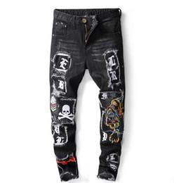 Jean design patché en Ligne-Jeans skinny Italie de créateur de mode masculine occasionnel en détresse lavé déchiré tigre crâne patchs brodés Denim Pants Stretch Slim