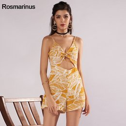 72243c688ef Yellow Floral Print Boho Strap Jumpsuit Romper Women Sexy Backless Bow Tie  Playsuit Female Summer Beach 2018 Shorts Overalls