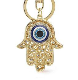 Wholesale Lucky Cross Metal - Lucky Hamsa Fatima Hand Eyes Keychains Charm Amulet Purse Bag Buckle Pendant For Car Keyrings key chains holder women