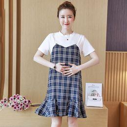 Vestiti di maternità del cotone della rappezzatura del plaid del cotone 2018 Vestiti coreani di modo di estate per le donne incinte Vestiti di gravidanza di galleggiamento da le donne coreane di estate rivestono fornitori