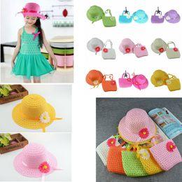 Wholesale baby sunhats - 9 colors Sunflower cap Children flower sunhat baby girls Casual Beach Sun Straw Hat+Straw Handbag 2pcs set for kids GGA411 60sets