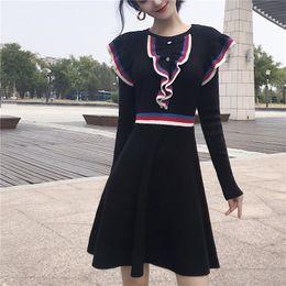 Chic 2018 Hiver Chandail Dress Femmes O-cou Long Manches Une Ligne Volants Tricot Mini Dress Moulante Femme Mince Fille Court ? partir de fabricateur