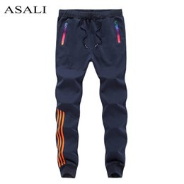Argentina 2018 New jogger Pants Men Casual Skinny Mens Track Pants Harem Sweatpants Chándal Pantalones inferiores Pantalones slim fit jogger de algodón S18102001 cheap mens fitted tracksuits Suministro
