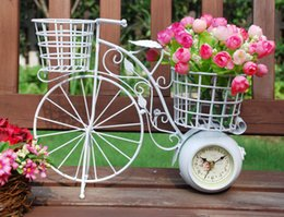 Wholesale Rustic Wrought Iron - Chinese fresh rustic decorations wrought iron bicycle flower basket double faced clock