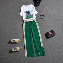 Costume de pantalon plus en Ligne-Nouveau été femmes costume automne mode 2 deux pièces ensemble plus la taille impression lâche t-shirt et pantalons ensembles causales femmes survêtements