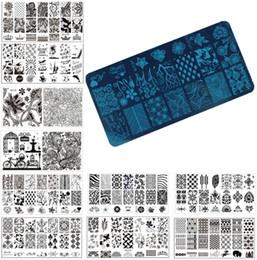 Timbratura di timbri di arte del chiodo online-All'ingrosso Nail Art Stamping Timbro Piatto di immagine 6 * 12 cm in acciaio inox Nail Template Manicure Stencil Tools 20 stili per scegliere