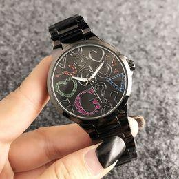 Reloj de pulsera de cuarzo de banda de acero de moda Big G estilo marca mujeres cristalino colorido GS 7155 desde fabricantes