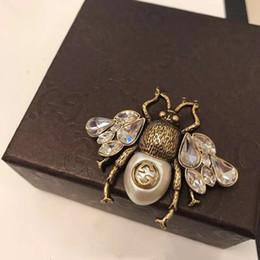 Gioielli swing online-Annata famosa marca rame oro con cristallo swing ape pin inset G Broon per i monili delle donne
