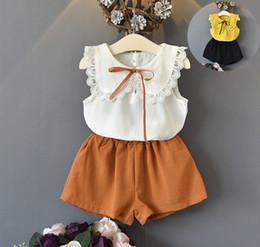 Wholesale down vest children - Summer new Girls lace hollow crochet ribbon lace-up Bows tie capes lapel vest tops+elastic shorts 2pcs sets children princess outfits Y5353
