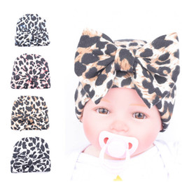 Wholesale korean style beanies - 4 Color Classic Print Leopard Knitted Cotton Hat Beanies With Bow Crochet Korean Style Winter Warm Caps For Newborn Toddler Baby