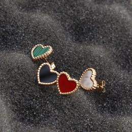 Argentina Versión coreana del pequeño encaje lindo corazón amor rojo rosa oro damas pendientes titanio acero chapado oro de 18 quilates color Suministro