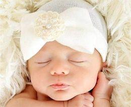 Baby Infant Bow Flower Hat Newborn Baby Pearl Beanie Crochet Caps Baby  Girls Boys Winter Warm Cotton Stripe Headwear Hair Accessories BH02 b0acaea1c2bf