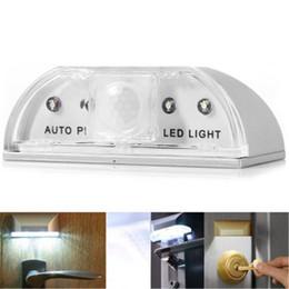 2019 batería baja led Sensor de movimiento de 4 LED Luz LED para iluminación automática. Perfil bajo. Batería de bajo consumo. Mini iluminación para abrir la puerta. batería baja led baratos