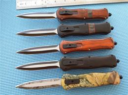 cuchillos delanteros fuera Rebajas BM doble acción fuera de los cuchillos de automóviles delanteros G10 mango 440C acero acabado negro Plain Tactical cuchillo con funda de nylon