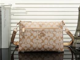 d9d3157ccdc Moda hombres y mujeres patrón de tela cara portátil pequeño bolso cuadrado  bolso de embrague de tendencia de la personalidad salvaje femenina bolso ...