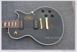 Guitarra de ébano de china online-Standard Ebony Fretboard Black Guitar Gold Hardwares Guitarra eléctrica China Guitarra Recién llegada