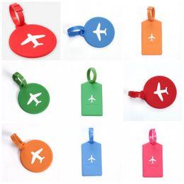 Etiquetas universales online-Etiqueta de equipaje de viaje Creativa Patrón de avión suave Etiqueta de bolso Rectángulo universal Forma redonda Etiquetas de bolsa de silicona Novedad 2 7 kg B