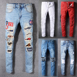 Wholesale Arrival Fly - 2018 New arrival quality famous novelty design men jeans ripped stylish biker jeans rock style patchwork straight men's jeans hot sale