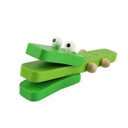 Les castagnettes de crocodile vert en bois de bande dessinée avec la poignée en bois frappent le jouet musical pour des enfants cadeau bébé bois musique jouets ? partir de fabricateur