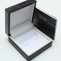 Boite de boutons de manchette noire design de luxe avec livret de service style classique. le dropship ? partir de fabricateur