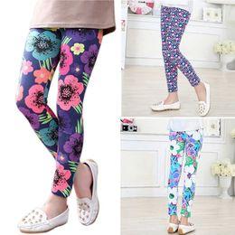 Pantaloni lunghi elastici stampati floreali del bambino dei pantaloni delle ghette delle ragazze dei bambini 2-14Y caldi supplier floral flower leggings da giacche da fiori floreali fornitori