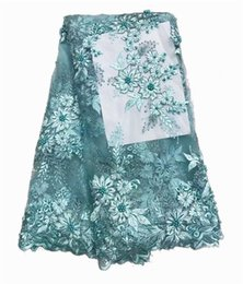 Nueva tela blanca africana francesa del cordón de la red del tul con los granos y las piedras Telas africanas del cordón de la boda nigeriana de la moda para el vestido l-1-1 desde fabricantes
