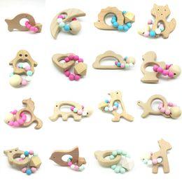 Anneaux de dentition de bébé de qualité alimentaire en bois de hêtre anneau de dentition jouets à mâcher jouets à mâcher douche jouer mâcher rondes perles en bois C5211 ? partir de fabricateur