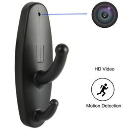Gancho de la cámara estenopeica online-Gancho de ropa Cámara de seguridad Percha de ropa Niñera Cámara de vigilancia con detección de movimiento Mini DVR Grabadora de video Agujero de alfiler