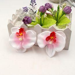 fiori di orchidea testa artificiale Sconti 100pcs Eco-Friendly / lotto 6.5cm farfalla in seta Orchid fiori artificiali Testa casa di cerimonia nuziale della decorazione Orchs Flores Cymbidium Fiori Piante