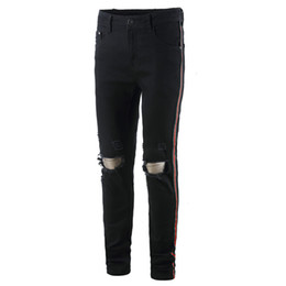Calça listrada preta on-line-Mens Side Striped Black Jeans Elastic Long Pencil Pants Ripped Hiphop Style Buracos