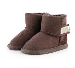 Argentina Promoción navideña botas de algodón WGG australianas ropa infantil niños y niñas bebé botas de nieve calientes niñas estudiantes botas de invierno nieve cheap girls pvc clothing Suministro