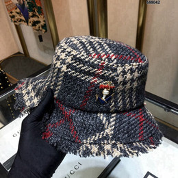 0a434f7c2cd Brand Winter Warmed Knitted Bucket Hats for Winter Designer Caps Fashion Women  Winter Brand Bucket Hat for Resort Party Fashion Accessories