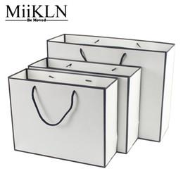 2019 sacs à main en couleur blanche MiiKLN Shopping Sac Papier Forte Shopping Pouch Pour Les Femmes Pour Les Vêtements 32*25*11