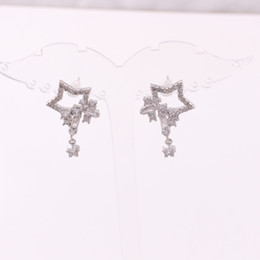 Boucles d'oreille en pierre en Ligne-Boucles d'oreilles étoiles à cinq branches cloutées avec des pierres de zircon claires