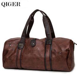 Wholesale vintage duffle bags - QIGER 2017 Luxury Men Leather Travel Bag Vintage Men Fashionable Duffle Bags High-Capacity Brown Shoulder Bag