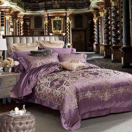 lila seidendecke Rabatt seide bettwäsche lila luxus stickerei bettwäsche set erwachsene bettdecke jecquard bettwäsche europäischen tröster heimtextilien 5 stück paar