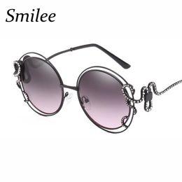 Сексуальные черные женские очки онлайн-Round Retro Sunglasses women Big Frame Double Circle Hollow sun glasses Elegant Swirl Snake Gold Crystal sunglasses sexy black