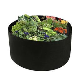 Jardín de montaje en pared online-Plantas de jardín Redondo montado en la pared Plantación Bolsa de cultivo de flores Vegetal Flor de aireación Plantar Bonsai Contenedor de raíz de poteA gallo