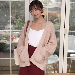 492493e4ad 2018 Autumn Cardigan Short Knitted Sweater Women Batwing Sleeve Pocket  Elastic Loose Warm Soft New Sweet Casual Outwear Knitwear