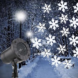 Lámpara cayendo online-Mini proyector de copos de nieve de navidad copos de nieve de navidad Luz láser LED Caída de nieve al aire libre Fiesta de Año Nuevo de Navidad a prueba de agua Lámparas