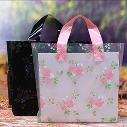 e82600aae5ed Black Clear Rose Flower Printed Gift Bags Plastic Shopping Carrier Bags  with Handle Gift Boutique Packaging Bags