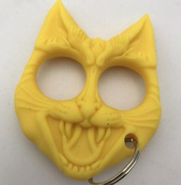 Wholesale wholesale tiger keychain - New yellow and Black Cat Head Keychain Knuckles Plastic hand buckle outdoor Self-defense tools Mini finger Tiger