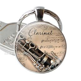 2019 cadeia de notas musicais Instrumento Musical Clarinete Guitarra Flauta Música Violino Chaveiro Pingente de Música Nota Chaveiro Chave Anéis De Vidro Dome Jóias desconto cadeia de notas musicais